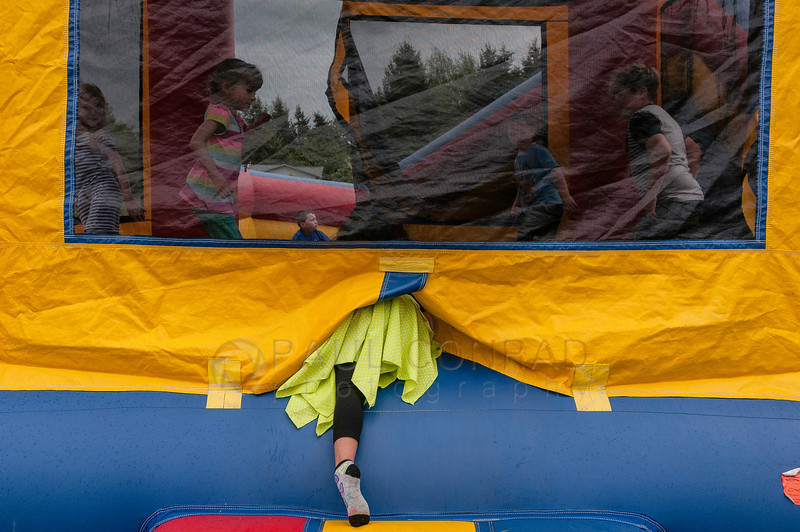 © Paul Conrad/ Pablo Conrad Photography - The guest of honor Xindi climbs into the Bouncy Castle during her birthday party on Saturday afternoon May 3, 2014.