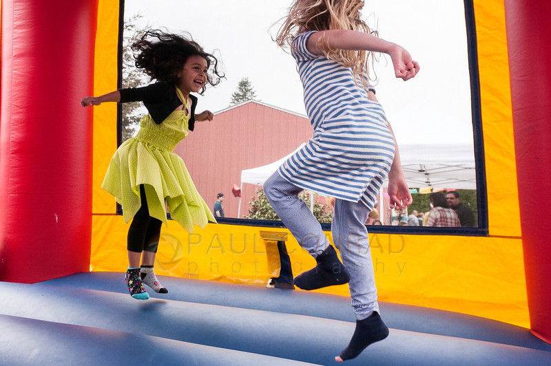 © Paul Conrad/ Pablo Conrad Photography - Xindi and a friend bounce the day away during her birthday party on Saturday afternoon May 3, 2014.