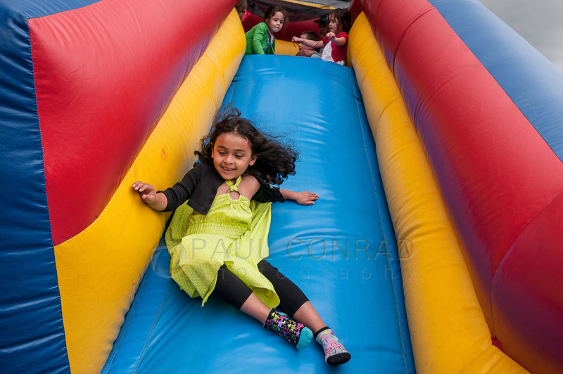 © Paul Conrad/ Pablo Conrad Photography - The guest of honor Xindi takes a slide during her birthday party on Saturday afternoon May 3, 2014.