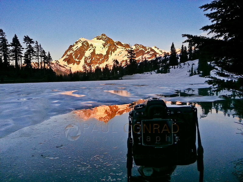 © Paul Conrad/Pablo Conrad Photography - Shooting the alpenglow on Mt. Shucksan while waiting for the rise of the super perigee Moon on Saturday evening June 22, 2013. As I liked the reflection better, I turned the center post of the tripod upside down to get my camera closer. Unfortunately, I inadvertently hit the focus ring and knocked it out of focus.