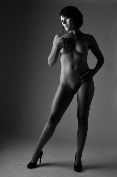 black and white nude model with mask