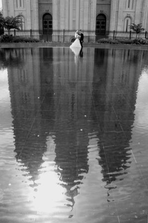 bride and groom in reflecting pool at SLC Temple