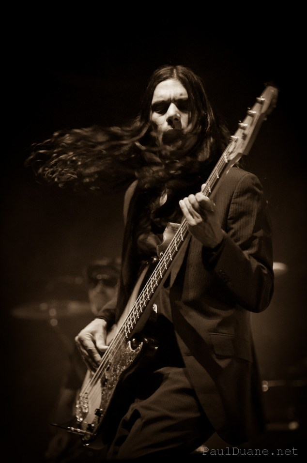 Ashish Vyas, bassist of Thievery Corporation sepia concert photo