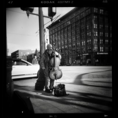 Elliot Street cellist. Holga film street photography Salt Lake City