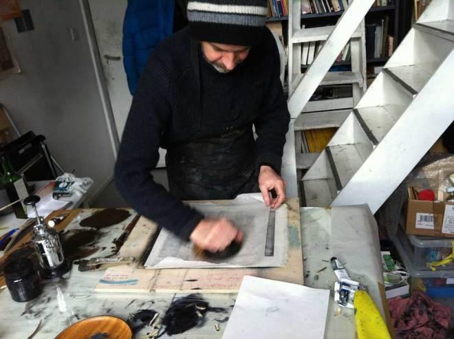Paul printing in his studio