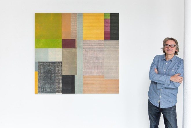 Paul Furneaux in front of large mounted-print