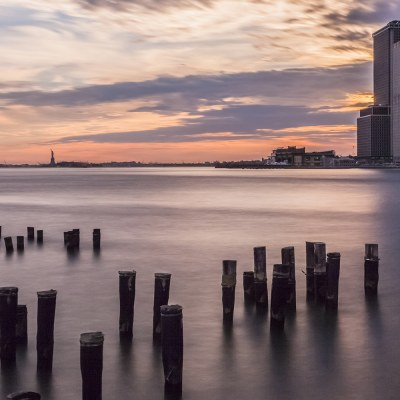 Sunset over New York and the Statue of Liberty New York Landscapes Architecture