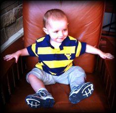 Daniel in the big boy's chair