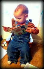 Daniel loves sitting in this little rocking chair and reading. Wonder where he gets that? :-)