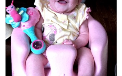 Lily is starting to sit up (and smile)