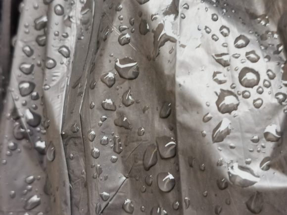 Garbage bag with rain drops splattered all over