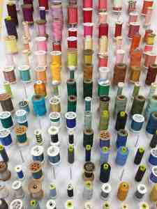 Spools of different colors of threads