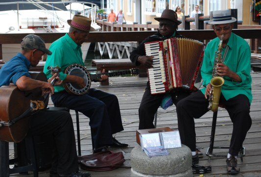 The band plays in Victoria Harbour