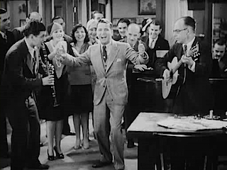 "Charles King sings the title tune in ""The Broadway Melody,"" 1929."