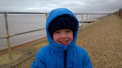 James enjoying a windy day by the sea in Dorset!