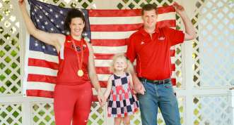 Stephanie Trafton with daughter and husband