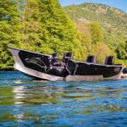 Black 17x61 Pavati Marine Drift Boat with Diamond Plate Floating on the River with the Drifter Doors Open