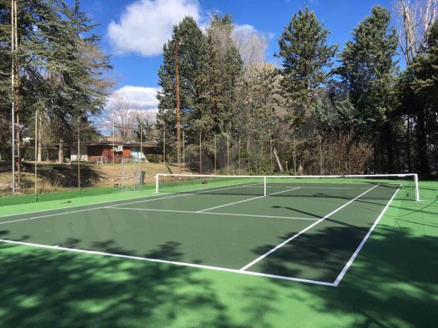 Limpieza pista tenis