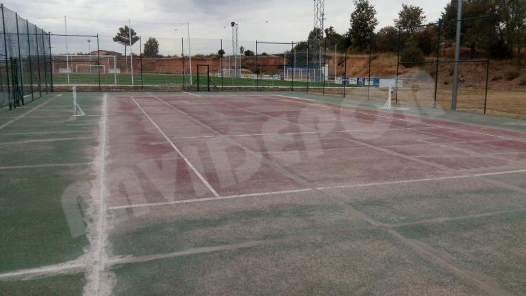 reparación pista de tenis