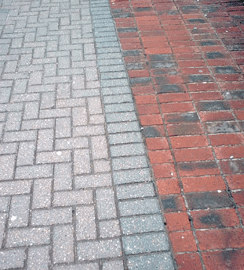 Clay and concrete block paving laid side-by-side on a driveway
