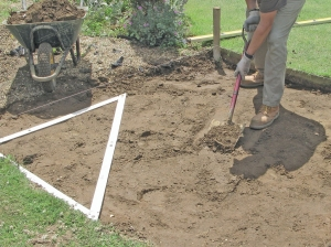 Dig out the soil that is to have the patio paving slabs laid