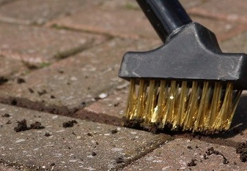 Use a wire brush for cleaning paving joints to save having to bend down to remove weeds