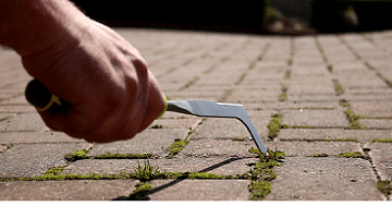 Use a weed removal tool for block paving joints to easily remove moss and weeds from the joints of patio or driveway pavers