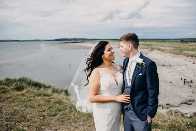 wedding portrait of bride and groom at rosses point beach