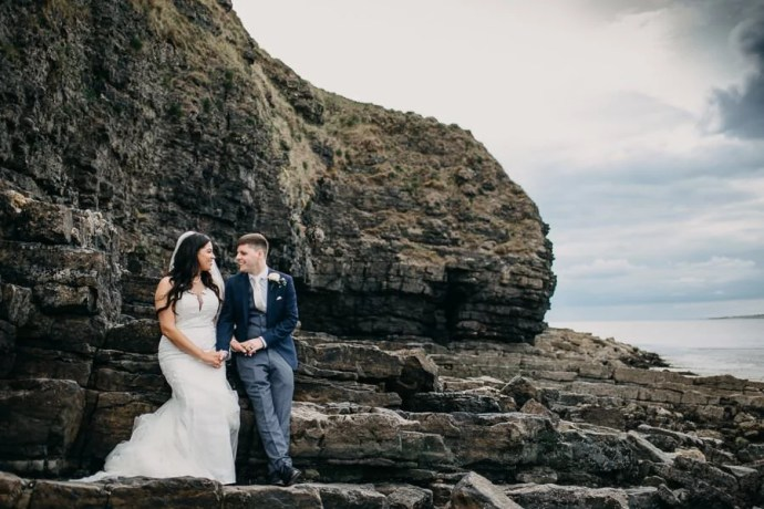 bride and groom at rosses point beach