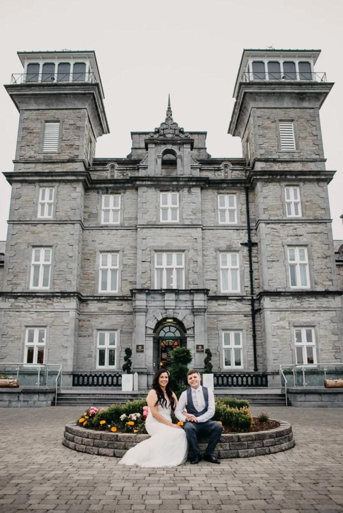 bride & groom in front of clayton hotel sligo