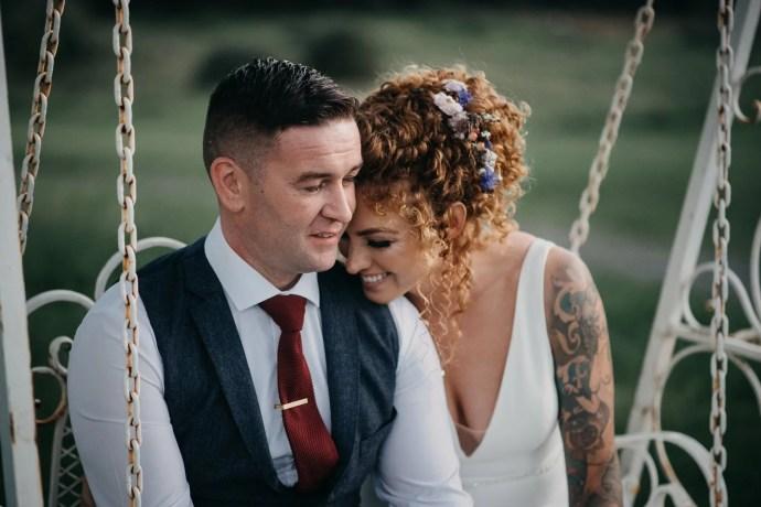 bride and groom on castle dargan's swing