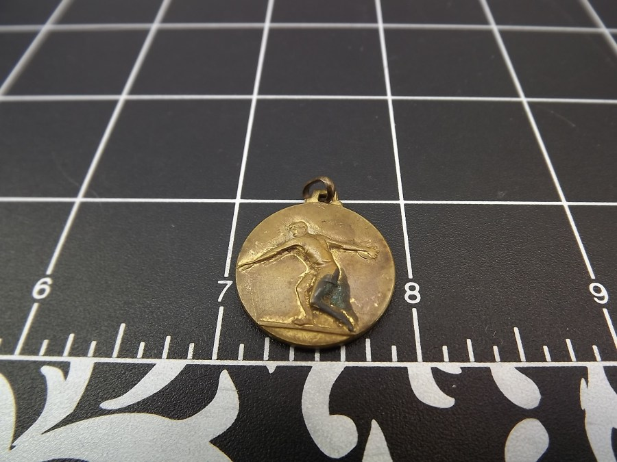 Bronze coin/medallion discus thrower award style metal not engraved definitely antique shape measures .75 inches in diameter 3