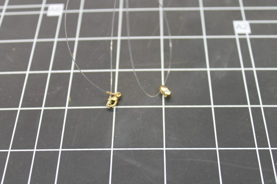 14KT YELLOW GOLD DIAMOND SOLITARE PENDANT ON CLEAR LINE 1.2GRAMS 2