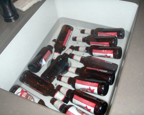 soaking the store-bought beer bottles in warm water and baking powder