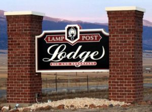 Lamp Post Lodge dimensional monument sign hand painted Westcliffe CO