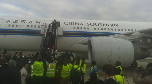 China Southern Airlines Chairman Si Xianmin (C) is welcomed by Kenyans upon his arrival at Jomo Kenyatta International Airport (JKIA) in Nairobi, Kenya.