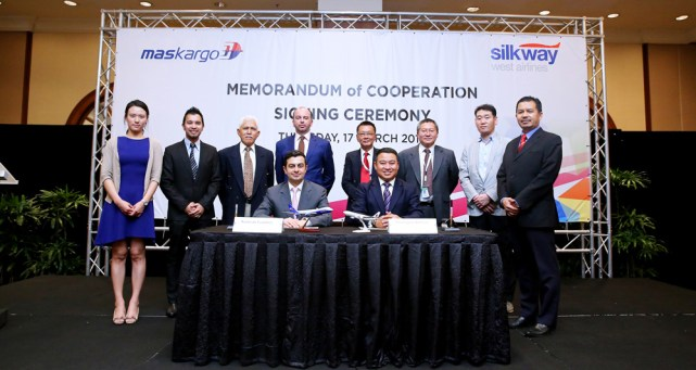 (front l-r) Kamran Gasimov, CEO of Silk Way West Airlines and Ahmad Luqman Mohd Azmi, CEO of MASkargo with the management teams of MASkargo and Silk Way West Airlines behind.