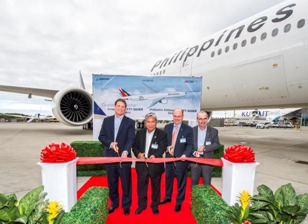 PAL's president & chief operating officer, Jaime Bautista (second left) celebrates the delivery with officials from Boeing and Intrepid Aviation