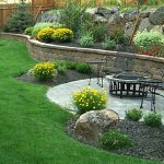 Iron table in beautifully landscaped garden