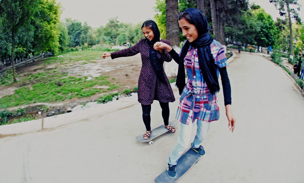 Skateistan youth leader Madina Khsrawy teaches another girl how to skateboard. Photo courtesy of Skateistan