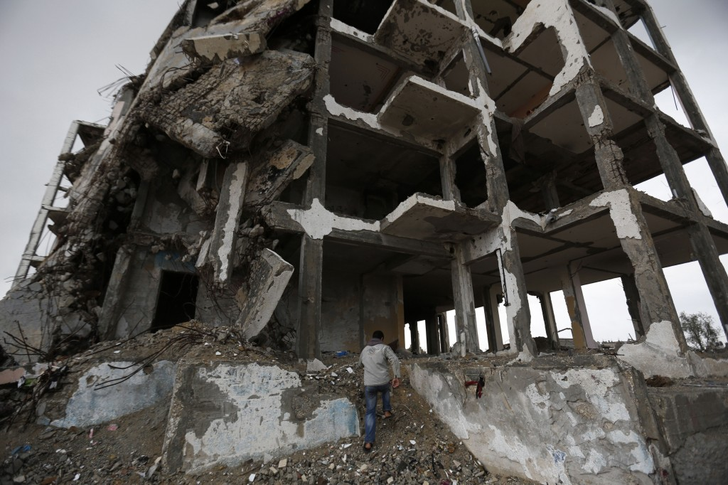 A building in the town of Beit Lahia in the Gaza Strip that was destroyed by Israeli shelling during a 51-day war in summer 2014, is seen here on Feb. 19, 2015. Photo by Mohammed Abed/AFP/Getty Images