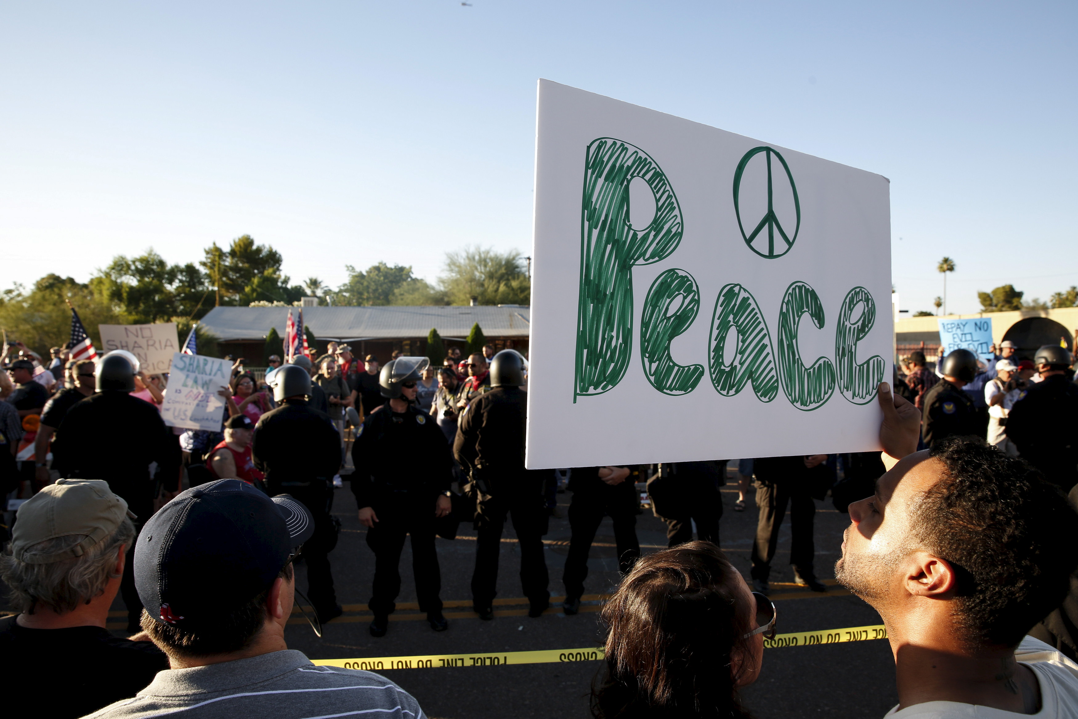"""Counter demonstrators look over to those attending the """"Freedom of Speech Rally Round II"""" outside the Islamic Community Center of Phoenix, Arizona May 29, 2015. Photo by Nancy Wiechec/Reuters."""