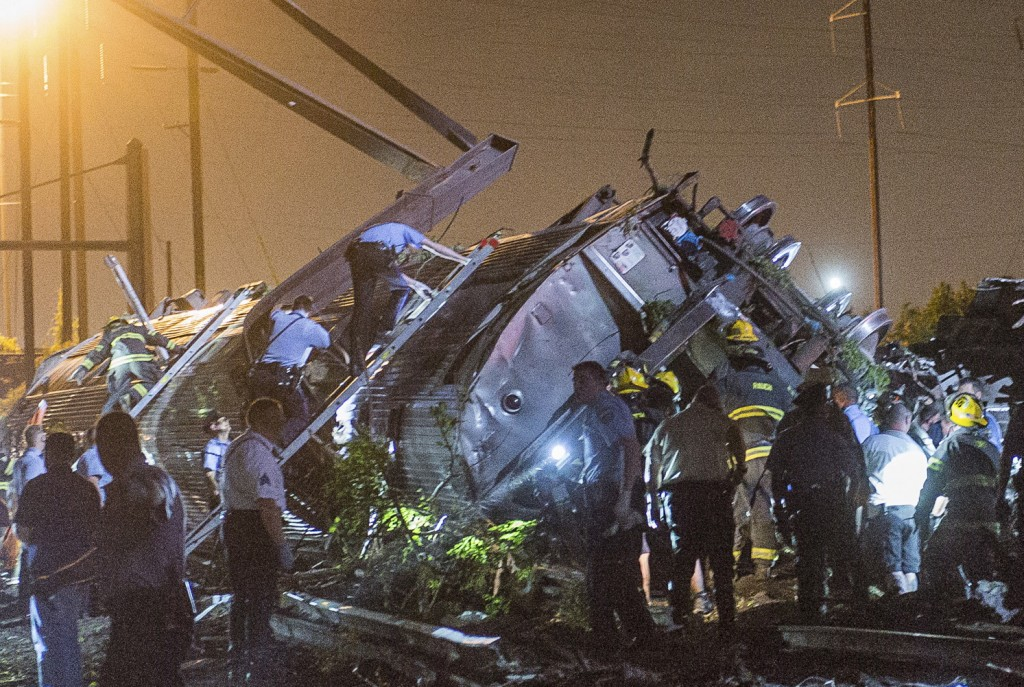 Rescue workers search for victims in the wreckage of a derailed Amtrak train in Philadelphia Tuesday night. A passenger train with more than 200 on board derailed in north Philadelphia on Tuesday night, killing at least five people and injuring more than 100, several of them critically, authorities said. Authorities said they had no idea what caused the train wreck, which left some demolished rail cars strewn upside down and on their sides in the city's Port Richmond neighborhood along the Delaware River. Photo by Bryan Woolston/Reuters