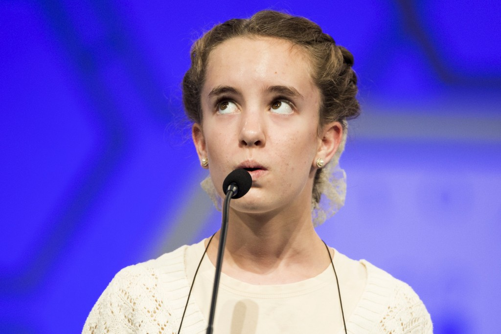 """Olivia Hajicek of Goshen, Indiana, spells the word """"chrysophyte"""" during the third round of the 88th annual Scripps National Spelling Bee at National Harbor, Maryland May 27, 2015. Spellers in the 88th annual bee range in age from nine to 15 and are the cream of more than 11 million hopefuls who took part in local contests. They come from eight countries and all 50 U.S. states, the District of Columbia, U.S. territories and Defense Department schools.  Photo by Joshua Roberts/Reuters."""