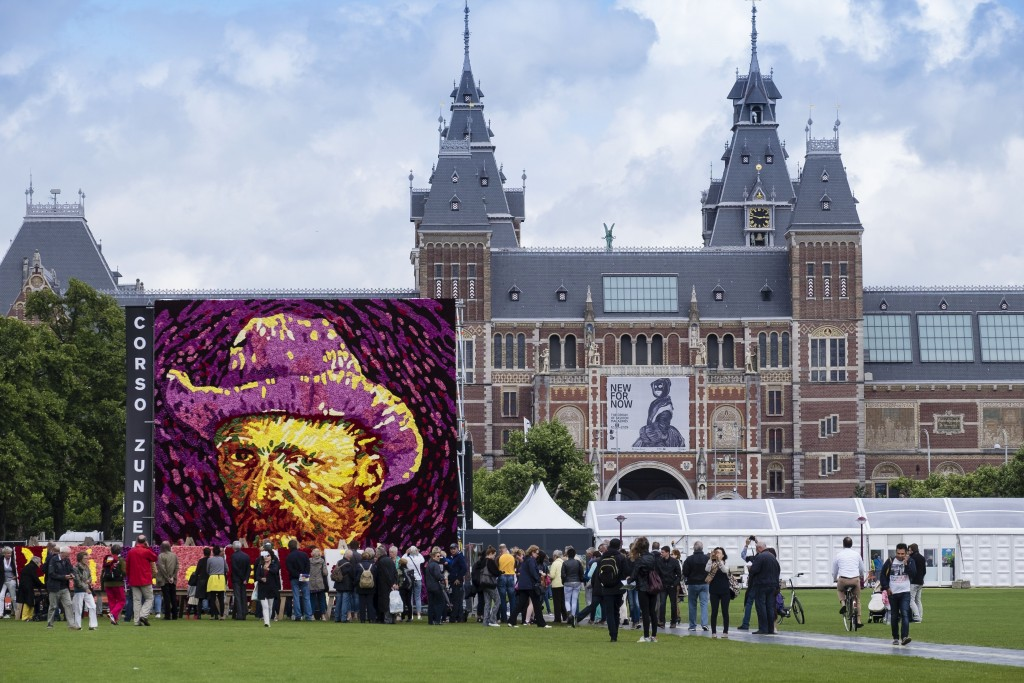 AMSTERDAM, NETHERLANDS - JULY 29:  A display of dahlias is erected to celebrate the 125th anniversary of Vincent van Gogh's death, on July 29, 2015 in Amsterdam, Netherlands. The 50,000 flowers were picked behind the house of the artist's birth in Zundert. (Photo by Michel Porro/Getty Images)