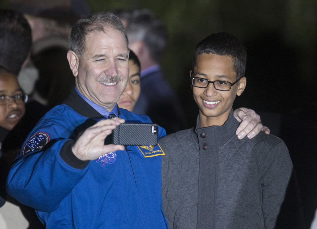 "John M. Grunsfeld (L), Associate Administrator for the Science Mission Directorate, poses for a selfie with Ahmed Mohamed, 14, the Texas teenager who was arrested after bringing a homemade electronic clock to school. The photo was taken during ""Astronomy Night"" at the White House on Oct. 19, 2015. Ahmed's family announced Tuesday that the Texas teen will move to Qatar next week to start school at the Qatar Foundation. Photo by Joshua Roberts/Reuters"