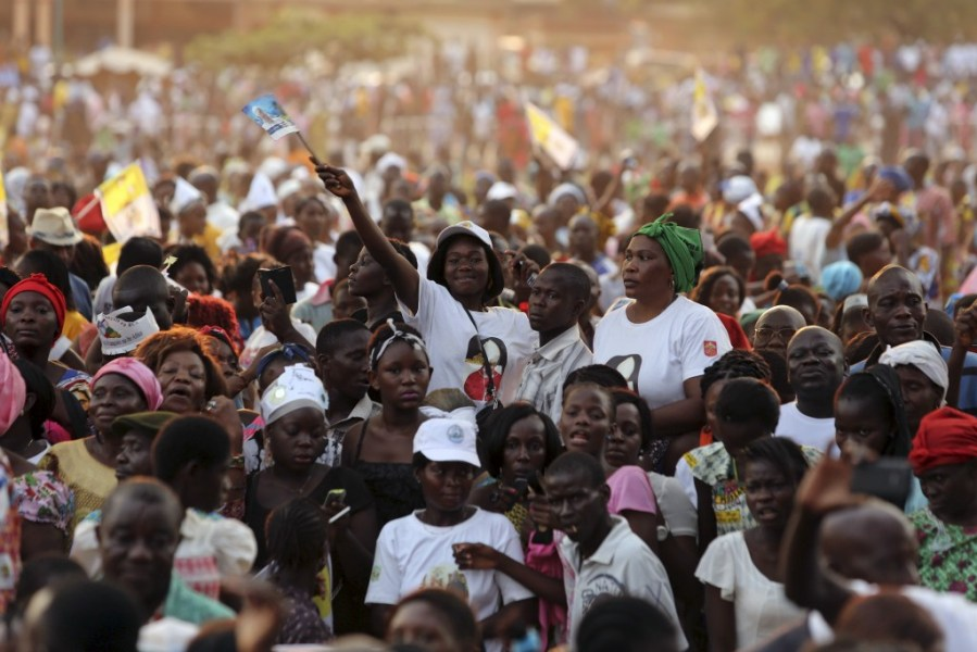 A crowd greets Pope Francis after he arrived at the Notre Dame Immaculate Conception Cathedral in Bangui on Nov. 29. He spent 24 hours in the Central African Republic during a trip to Africa. Photo by Siegfried Modola/Reuters