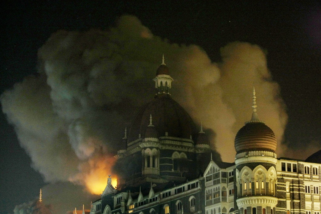 ** FILE **In this Thursday, Nov. 27, 2008, fire engulfs a part of the Taj Hotel in Mumbai, India. Teams of gunmen stormed luxury hotels, a popular restaurant, hospitals and a crowded train station in coordinated attacks across India's financial capital,taking Westerners hostage and leaving parts of the city under siege. The terror lasted for three day which killed 195 people. (AP Photo/Gautam Singh)