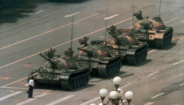 A man stands alone to block a line of tanks heading east on Beijing's Cangan Blvd. in Tiananmen Square on June 5, 1989. (AP Photo/Jeff Widener)