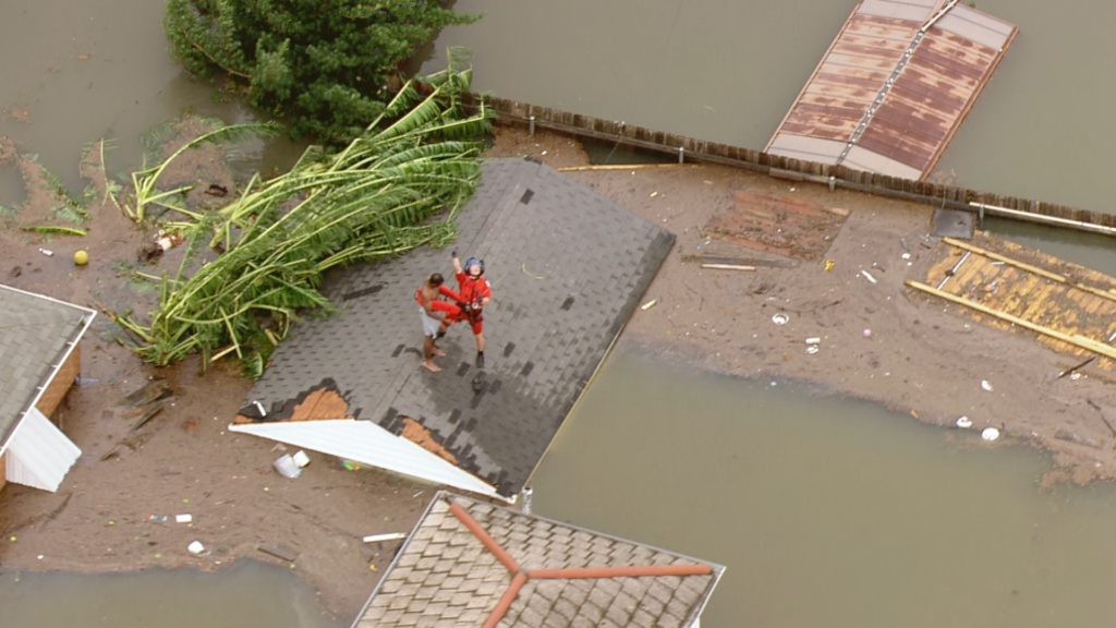 A New Orleans resident is rescued in the aftermath of Hurricane Katrina.